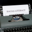 a typewriter with 'racial literacy' on the paper