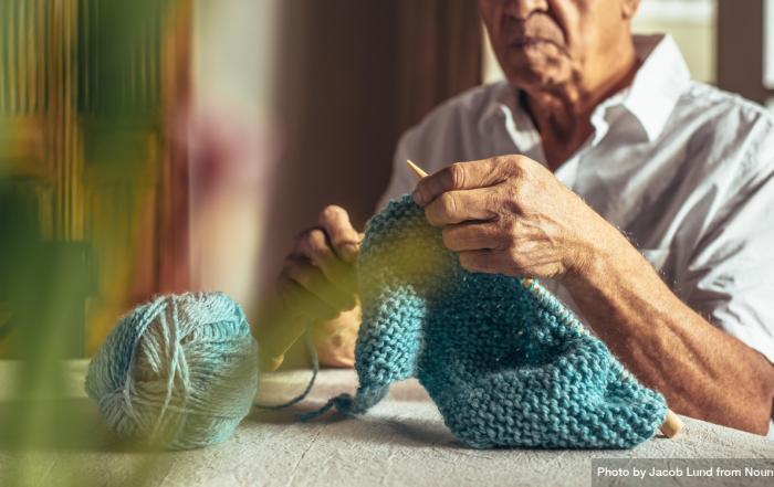 older man knitting
